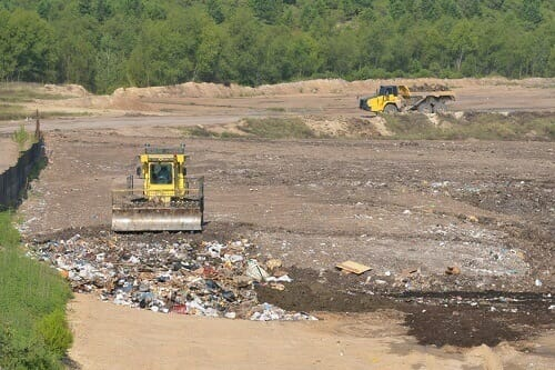 Heavy Machines Working On Sanitary Landfill